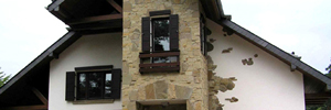 Out of Town Wood frame family house, Straw bale wall design, Stucco with natural stone accents applied to the exterior walls